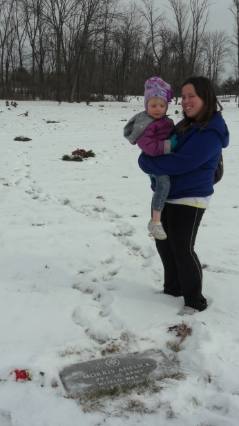 My sister and niece at Grandpop's grave, January 2014.