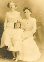 Young Julia and her sisters, Helen (standing) and Mary (seated).